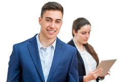 Young businessman with partner in background. Stock Images