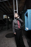 Young businessman on the pay phone Royalty Free Stock Images