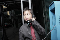 Young businessman on the pay phone Stock Photography