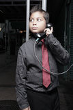 Young businessman on the pay phone Royalty Free Stock Image
