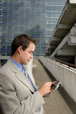 Young businessman with PDA royalty free stock photos