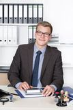 Young businessman is performing calculations Stock Photos