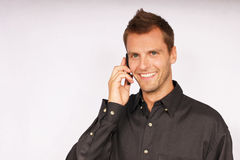 Young businessman with phone Royalty Free Stock Photography