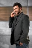 Young businessman on phone Royalty Free Stock Photos