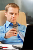 Young businessman with phone. This is a close-up of a young businessman with phone stock photo