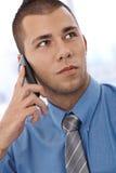 Young businessman on phone Stock Photos