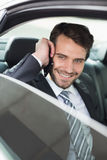 Young businessman on the phone. In his car Royalty Free Stock Images