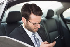 Young businessman on the phone. In his car Royalty Free Stock Photos