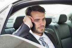 Young businessman on the phone. In his car Stock Image
