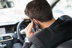 Young businessman on the phone. In his car Stock Images