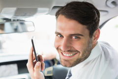 Young businessman on the phone. In his car Stock Photos