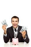 Young businessman with piggy bank Royalty Free Stock Images