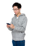 Young businessman play the game on cellphone Stock Photography