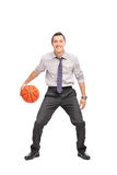 Young businessman playing basketball Royalty Free Stock Photo
