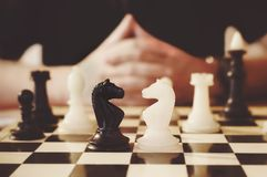 Young businessman playing chess Royalty Free Stock Photography