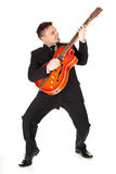 Young businessman playing on lectric guitar Royalty Free Stock Photography