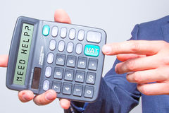 Young businessman pointing on calculator.Need Help? Vat Sign. Ta Stock Image