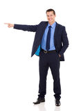 Young businessman pointing. Cheerful young businessman pointing on white background Royalty Free Stock Photo