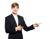 Young businessman pointing at copyspace Royalty Free Stock Photography