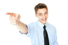 Young businessman pointing finger Royalty Free Stock Image