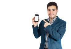 Young businessman pointing his phone. Young businessman pointing something in his phone royalty free stock images