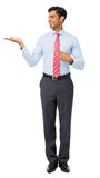 Young Businessman Pointing At Invisible Product Stock Photography
