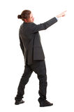 Young businessman pointing at something Royalty Free Stock Photos