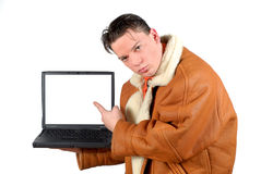 Young businessman pointing to blank  laptop screen Stock Images