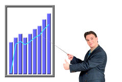 Young businessman pointing to chart. Young businessman pointing to a (fictitious) chart, diagram. Business, communication, economy, corporate concept Stock Photos