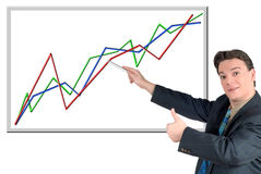 Young businessman pointing to chart Stock Photos