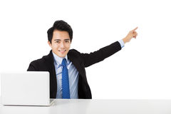 Young Businessman pointing to copy space Stock Photo