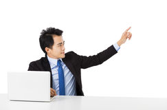 Young Businessman pointing to copy space Royalty Free Stock Photography