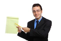 Young businessman pointing to a legal pad Royalty Free Stock Images