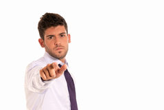 Young businessman pointing to you with copy-space Stock Photo