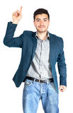 Young businessman pointing up at white background Royalty Free Stock Photos