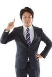 Young businessman pointing upward Stock Photography