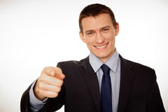 Young businessman pointing at you. Stock Image