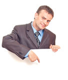Young businessman points his finger Royalty Free Stock Image