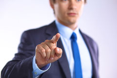 Young businessman points his finger at an object Stock Images