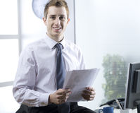 Young businessman. Portrait of young businessman in his office Stock Images