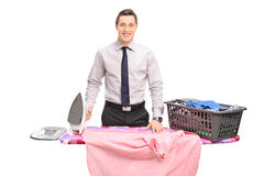 Young businessman posing behind an ironing board Royalty Free Stock Photos
