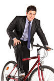 Young businessman posing on a bicycle Stock Images