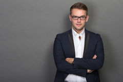 Young businessman posing chic with glasses on Stock Images