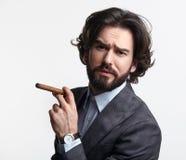 Young businessman posing with cigar Stock Photos