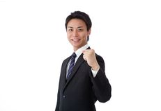 Young businessman posing guts Royalty Free Stock Photo
