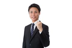 Young businessman posing guts Royalty Free Stock Photos