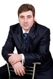 Young businessman posing in a suit. Isolated in white Stock Photo