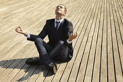 Young businessman in the position of the lotus Stock Photography