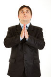 Young businessman praying for success isolated Royalty Free Stock Photos