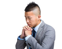 Young Businessman praying to the lord Stock Photos